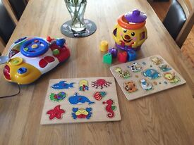 Collection of toys, wooden jigsaws and more.