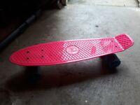 Pink junior skate board