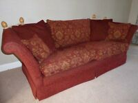 A pair of comfortable large Victoria sofas by Wade Upholstery in terracotta and gold fabric