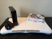 Black Nintento Wii + Wii fit board + Zelda, Zumba and Sports/Fit games