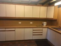 Kitchen unit and cupboards with integrated fridge