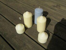 Five decorative wax candles