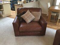 Snuggle chair brown leather