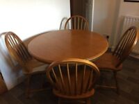 Beautifully made table withmatching chairs in excellent condition. Collection only.