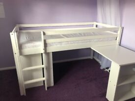 Child's white mid height sleeper bed and pull out desk