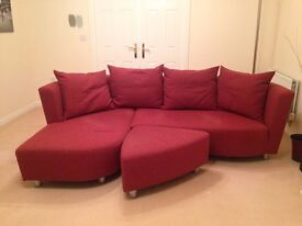 Dark red Hulsta sofa with chaise longue extension plus stool