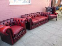 A Red leather chesterfield suite