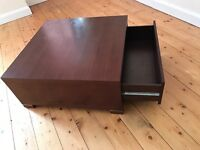 Coffee Table with side drawer.