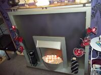 Silver glass fireplace with electric fire - ornaments not included
