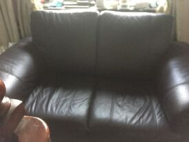 Leather two seater settee colour dark brown very good condition