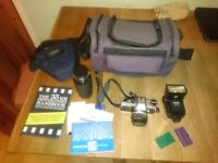 Olympus OM10 35mm slr film camera. Inc 200mm zoom lens and accessories.