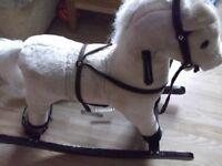 CHILD'S ROCKING HORSE WITH SOUNDS/SADLE