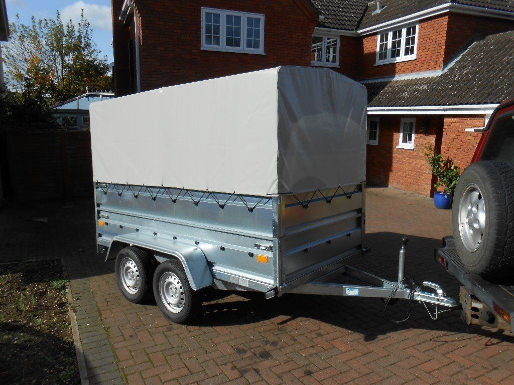 Twin axle trailer with canopy.