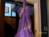 Stunning proms dress. Light Purple with crystal trims.