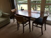 Solid wood expandable dining table (seats 6) + 3 chairs