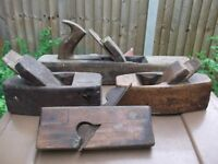 Assorted old hand tools, braces, saws and planes