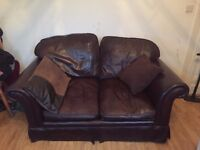 Lovely leather brown two seater sofa, very good condition