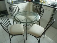 Glass and Metal Table and Four Chairs
