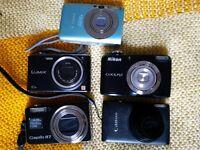 Five broken cameras... for parts and spares