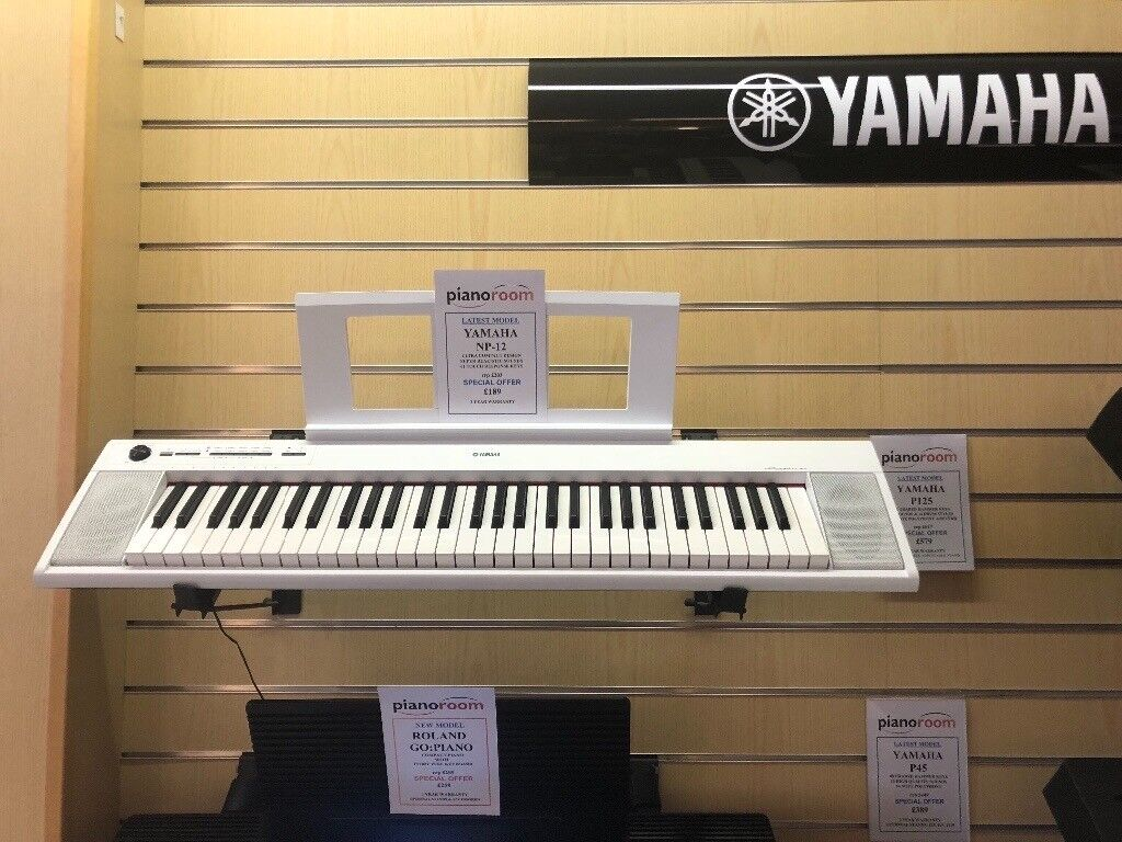 white yamaha np 12 electric keyboard with stand in exeter devon gumtree. Black Bedroom Furniture Sets. Home Design Ideas