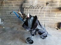 Golf clubs with bag and trolley
