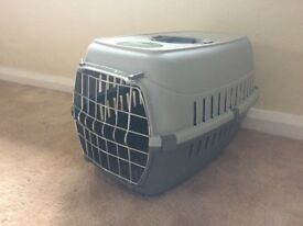 Cat/small dog carrier. (reserved)