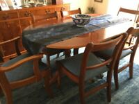 Dining room suite with extending table 4 chairs and 2 carvers and matching sideboard