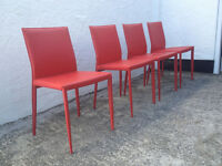 Four contemporary red leather dining chairs