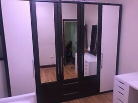 Wooden wardrobe, matching wooden chest of draws and leather mirror- brown and beige £150 ono