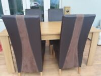 Oak veneer dining table and 4 brown faux leather/ suede chairs