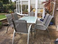 Six seater patio set, table and chairs, with side table and stools