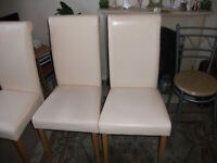 3 cream coloured faux leather dining chairs