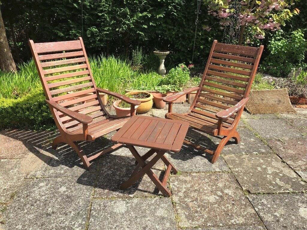 Two wooden garden loungers and table
