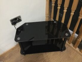 Black glass topped television table