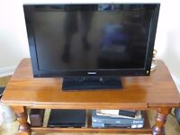 """Toshiba TV 31"""" screen Sony DVD and timber table"""