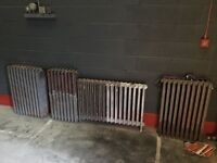 Selection of cast iron radiators.