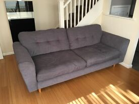 DFS Sofa and Armchair with storage foot stall.