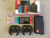 Nintendo Switch console and Mario Kart game + Carry case and Steering wheels