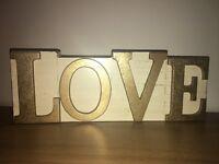 Gold love plaque