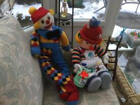 Knitted clown and his builder friend