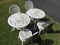 White metal garden tables and chairs