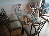 Glass dining table with 6 chairs (in great condition selling due to not using)
