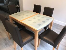 Glass/wood dining table with free 6 chairs