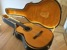 Spanish classical Cordoba guitar with hard case and tuning fork