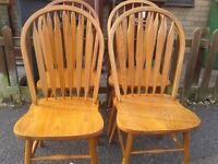 4 dining chairs,solid oak,Windsor,a little wear,match my round dining table