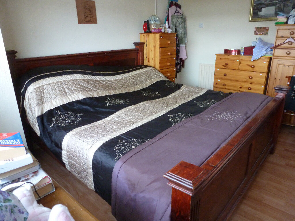 Super King Size Bed in solid oak with medium soft mattress. Both in excellent condition