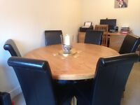 Round Oak Dining Table with 6 Black Leather Chairs