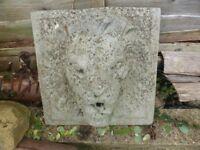 Lion wall mounted garden fountain.