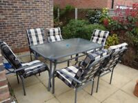 patio table, chairs,cushions