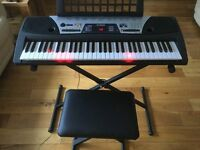 Yamaha EZ150 electric Keyboard, c/w stand and stool